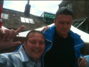 Moorhouse posing with Tommy Robinson