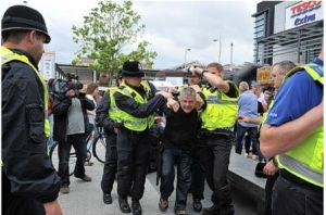John Claydon is arrested after the assault during the EDL march in Hull.