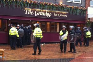 Riot police outside the Granby pub in Nuneaton