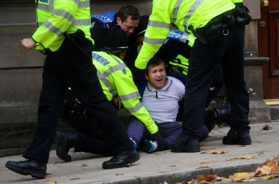 Britain First supporter David Davis is wrestled to the floor by police