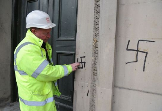 Billy Duggan, from Duggan & Parr Stone Repair Ltd, surveying the graffiti on St George's Hall