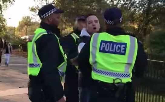 Daniel Thomas is led away by police from Speakers' Corner, Hyde Park, London