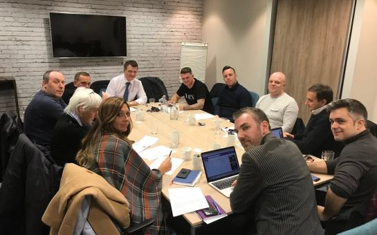 Gerard Batten, in the white shirt and blue tie, sitting to the left of Tommy Robinson, with Daniel Thomas to his right, at the Ukip demo planning meeting Credit: Gerard Batten/Twitter