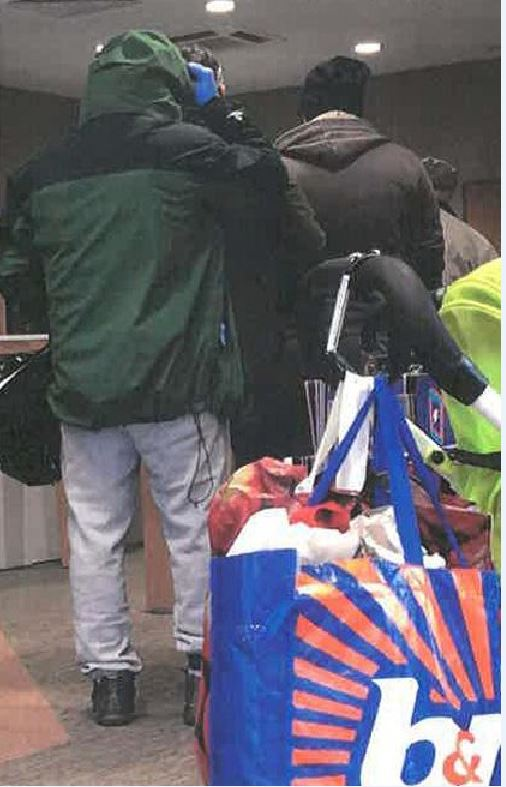 Simon Jones, 38, queued behind other customers in Bishop Auckland for 15 minutes wearing blue latex gloves, a hooded top pulled up, a face mask and dark glasses. He was also carrying a bottle of Febreze and a hold-all