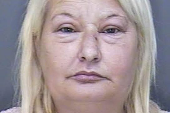 Racist alcoholic Leah Neville spat and kicked a police officer